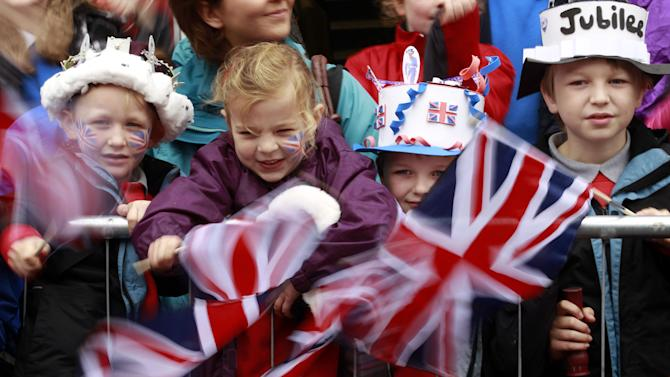 Children wait to catch a view of Britain's Queen Elizabeth II outside a Service of Thanksgiving in Saint Macartin's Cathedral in Enniskillen, Northern Ireland, Tuesday, June 26, 2012. The Queen arrived in Northern Ireland for a two day visit to mark the Queen's Diamond Jubilee. (AP Photo/Peter Morrison)
