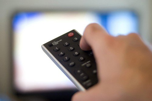 Watching TV is a public health problem comparable with issues such as smoking and obesity, warns report