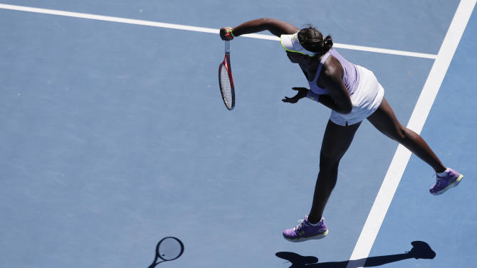 loane Stephens of the US serves to compatriot Serena Williams during their quarterfinal match at the Australian Open tennis championship in Melbourne, Australia, Wednesday, Jan. 23, 2013. (AP Photo/Rob Griffith)
