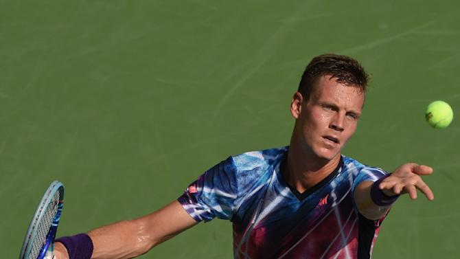 Tomas Berdych of the Czech Republic hits the ball against Bjorn Fratangelo of the US during their US Open men's singles match on September 1, 2015 in New York