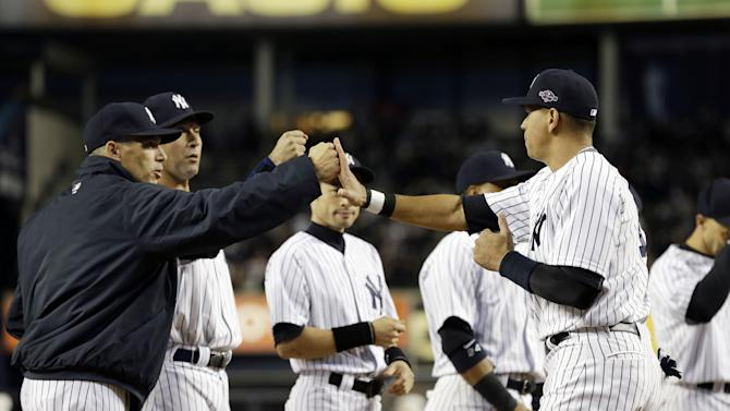 New York Yankees Alex Rodriguez, right, is greeted by manager Joe Girardi, left, and Derek Jeter during ceremonies before Game 1 of the American League championship series against the Detroit Tigers Saturday, Oct. 13, 2012, in New York. (AP Photo/Paul Sancya )