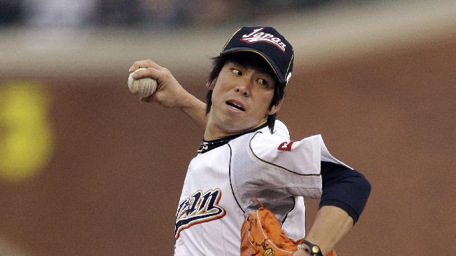 Japan's Kenta Maeda pitches during the first inning of a semifinal game of the World Baseball Classic against Puerto Rico in San Francisco, Sunday, March 17, 2013. (AP Photo/Ben Margot)