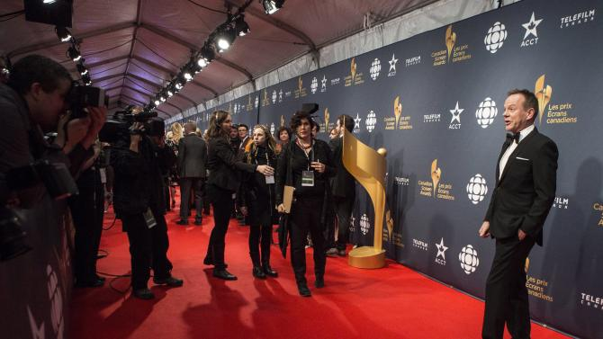Keifer Sutherland arrives on the red carpet at the 2015 Canadian Screen Awards in Toronto on Sunday, March 1, 2015. (AP Photo/The Canadian Press, Chris Young)