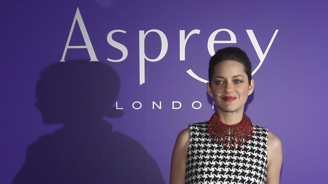 """Actress Marion Cotillard arrives at the EE British Academy Film Awards Nominees Party at Asprey, in central London, in this photo dated Saturday Feb. 9, 2013.  Cotillard is considered a major contender to pick up awards for """"Rust and Bone"""", during the upcoming awards season, according to reports by bookmakers published Sunday. (AP Photo/Lewis Whyld, PA) UNITED KINGDOM OUT - NO SALES - NO ARCHIVES"""