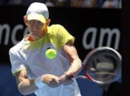 Kevin Anderson hits a return against Jo-Wilfried Tsonga at the Hopman Cup on January 4, 2013. Anderson became the first South African to reach the semi-finals of the Sydney International in nine years with victory over Denis Istomin on Thursday