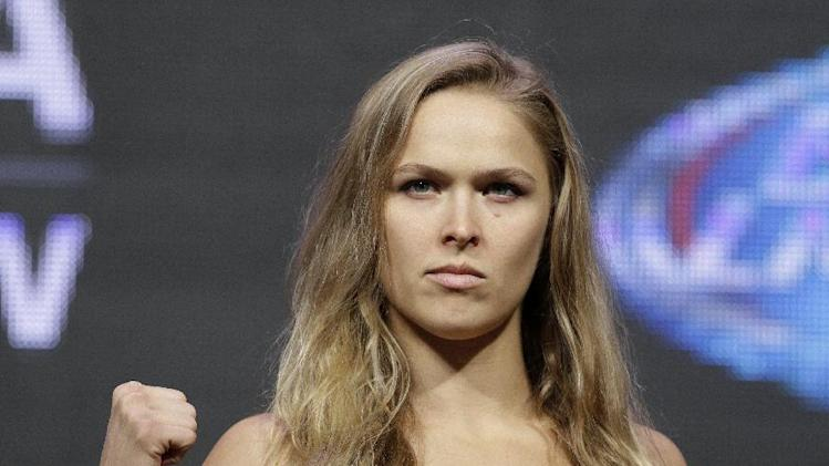 Ronda Rousey poses for photographers during a weigh-in for the UFC 175 mixed martial arts event at the Mandalay Bay, Friday, July 4, 2014, in Las Vegas. Rousey is scheduled to fight Alexis Davis in a women's bantamweight title fight on Saturday in Las Vegas