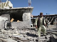 Afghanistan security forces survey the site of a suicide attack in Lashkar Gah, capital of Helmand province in southern Afghanistan. The Afghan government could implode after NATO troops pull out in 2014, particularly if presidential elections are fraudulent, a report by the International Crisis Group says
