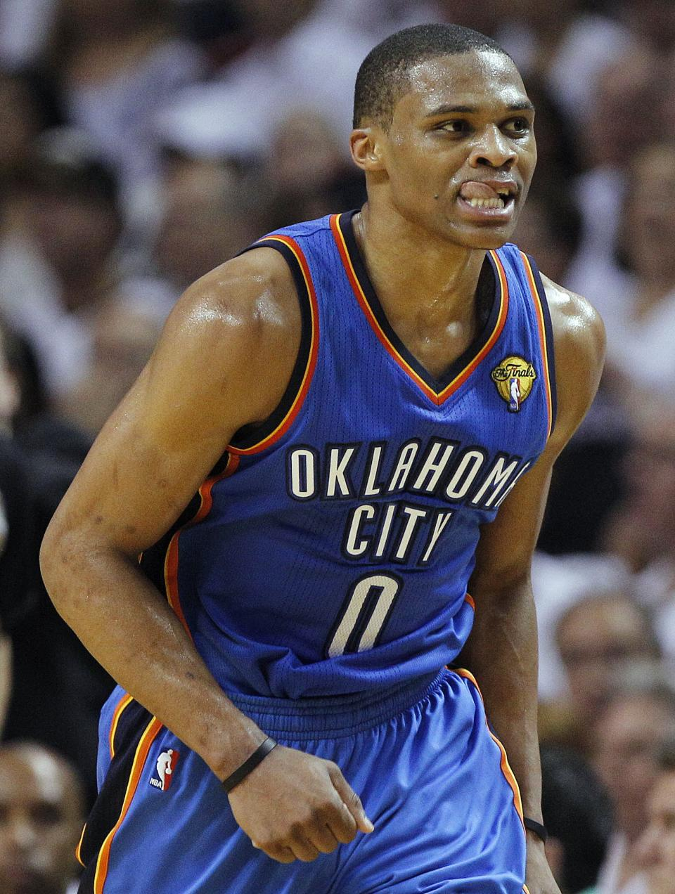 Oklahoma City Thunder point guard Russell Westbrook heads down the floor against the Miami Heat during the first half of Game 4 of the NBA Finals basketball series, Tuesday, June 19, 2012, in Miami.  (AP Photo/Lynne Sladky)