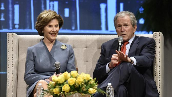 Former President George W. Bush and his wife Laura speak during a Fireside Chat Friday, Feb. 27, 2015 at Christ's Church in Jacksonville, Fla. The talk was part of the church's fundraiser for the K-12 prep school, Christ's Church Academy.  (AP Photo/The Florida Times-Union, Will Dickey)