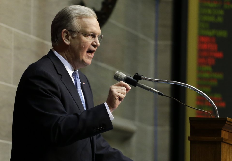 FILE - In this Jan. 28, 2013 file photo, Missouri Gov. Jay Nixon delivers the annual State of the State address to a joint session of the House and Senate in Jefferson City, Mo. With the help of a few Democrats, Missouri's Republican-led Legislature appears to be positioned to override Nixon's veto of a high-profile bill that seeks to nullify federal gun-control laws in the state and make criminals out of federal agents who attempt to enforce them. (AP Photo/Jeff Roberson, File)