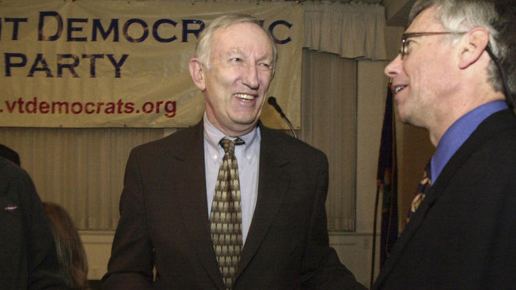 FILE - In this March 14, 2003, file photo, Sen. Jim Jeffords, I-Vt., center, laughs with Vermont Democratic Party Chairman Scudder Parker at the annual Democratic Party dinner in Montpelier, Vt. Jeffords, who in 2001 tipped control of the Senate when he quit the Republican Party to become an independent, died Monday, Aug. 18, 2014, in Washington. He was 80. His funeral is scheduled for Friday, Aug. 22, 2014 at the Grace Congregational United Church of Christ in downtown Rutland, Vt. (AP Photo/Toby Talbot, File)