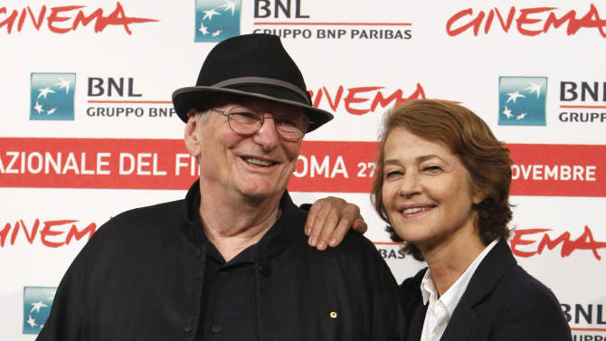 """Australian director Fred Schepisi, left, poses with British actress Charlotte Rampling during a photocall to present his new movie """"The eye of the storm"""" at the 6th edition of the Rome International Film Festival in Rome, Sunday, Oct. 30, 2011. (AP Photo/Riccardo De Luca)"""