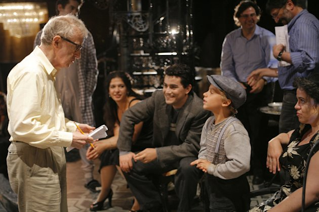 "This Aug. 21, 2008 photo released by the LA Opera shows director Woody Allen, left, speaking with a young cast member as Albanian tenor Saimir Pirgu, center, looks on during a rehearsal of ""Gianni Schicchi"" in Los Angeles. At 31, Pirgu is an even hotter hire in the music business, having worked closely with two of The Three Tenors who were stadium megastars _ Placido Domingo and the late Luciano Pavarotti. He's appearing with the San Francisco Opera in Bellini's ""I Capuleti e i Montecchi,"" a reworking of the Romeo and Juliet story that runs through Oct. 19. (AP Photo LA Opera, Robert Millard)"