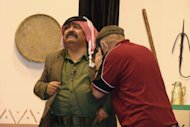 "Image provided by Amman's Concorde Theatre shows Jordanian comedian Musa Hijazin (L) in the role of Abu Saqer in the satirical play ""Now, I understand You"" in Septemer 2011. Every week, Jordanians pack the Concorde theatre to laugh at the shortcomings of their government and regional politicians still resisting the Arab Spring"
