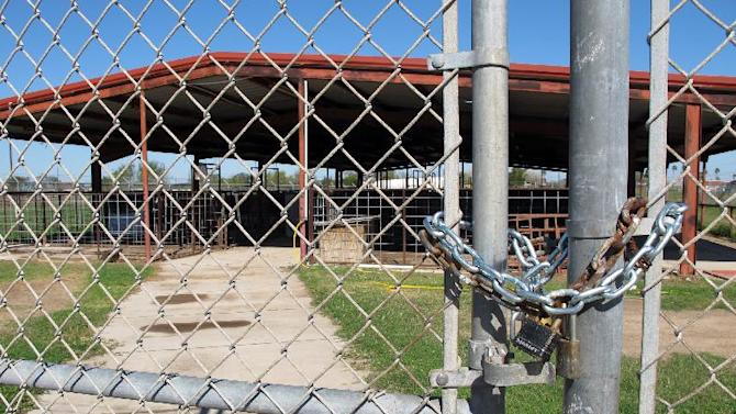 The La Villa Independent School District's farm sits locked up in La Villa, Texas, Monday, Jan. 13, 2014. A water payment dispute between the city and school district has shut down the schools and forced students to move their livestock elsewhere. (AP Photo/Chris Sherman)