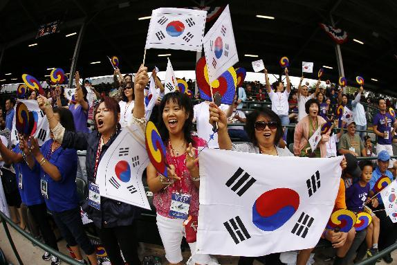 Fans and family of the little league team from South Korea cheer during the International Championship baseball game between Japan and South Korea at the Little League World Series tournament in South Williamsport, Pa., Saturday, Aug. 23, 2014