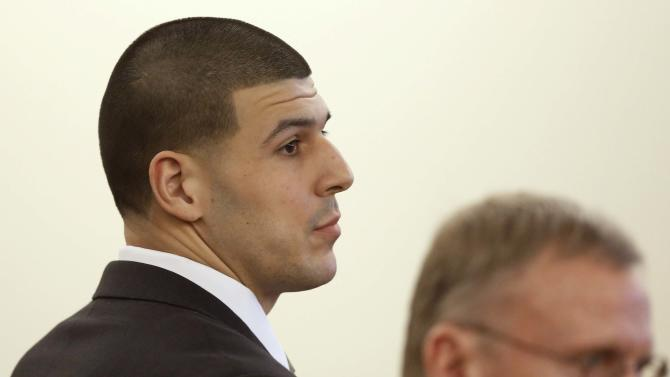 Former New England Patriots football player Hernandez and defense attorney Rankin listen during his trial in Fall River