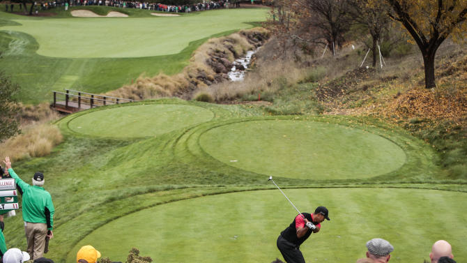 Tiger Woods tees off on the 16th hole during the final round of the World Challenge golf tournament at Sherwood Country Club in Thousand Oaks, Calif., Sunday, Dec. 2, 2012. (AP Photo/Bret Hartman)