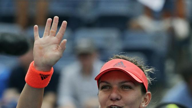 Simona Halep, of Romania, waves to fans after defeating Kateryna Bondarenko, of Ukraine, during the second round of the U.S. Open tennis tournament, Thursday, Sept. 3, 2015, in New York. (AP Photo/Charles Krupa)