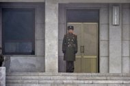 "A North Korean soldier stands guard at the truce village of Panmunjom on February 27, 2013. The United States and China on Tuesday called on the UN Security Council to sanction North Korean diplomats and ""illicit"" cash transfers to step up pressure on Pyongyang's nuclear program"