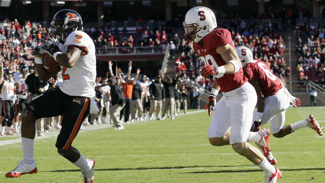 Oregon State wide receiver Markus Wheaton (2) scores on a 23-yard touchdown pass in front of Stanford safety Ed Reynolds (29) during the third quarter of an NCAA college football game in Stanford, Calif., Saturday, Nov. 10, 2012. (AP Photo/Jeff Chiu)