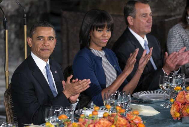 U.S. President Barack Obama, first lady Michelle Obama, and Speaker of the House Boehner clap during the Inaugural Luncheon in Washington