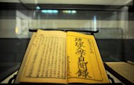 A Qing dynasty volume with a yellowed title page in bold, black characters from the 1760s about Ryukyuan students sits on display in a glass case at the Imperial College in Beijing on October 10, 2012. Some Chinese nationalists say that the 18th century book is evidence that a swathe of modern-day Japan belongs to China