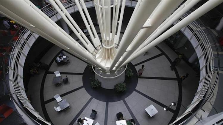 A general view shows workers at a cafeteria inside a building at the Infosys campus at the Electronic City area in Bangalore September 4, 2012. REUTERS/Vivek Prakash/Files