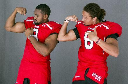 Utah defensive end Nate Orchard, left, and wide receiver Dres Anderson, pose for photos at the Pac-12 NCAA college football media days at Paramount Studios in Los Angeles, Wednesday, July 23, 2014. (AP Photo)