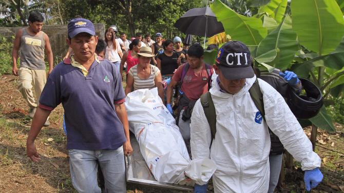 People move the bodies of soldiers killed by FARC, in Santander de Quilichao, Cauca