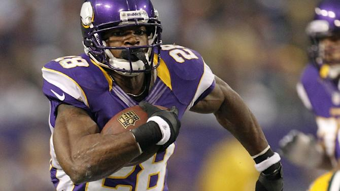 Minnesota Vikings running back Adrian Peterson (28) runs from Green Bay Packers inside linebacker Brad Jones (59) during the first half of an NFL football game Sunday, Dec. 30, 2012, in Minneapolis. (AP Photo/Genevieve Ross)