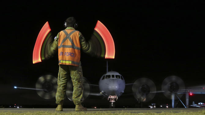 Australian PM vows search for jetliner will go on