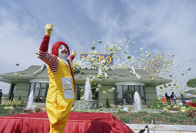 FILE - In this file photo taken April 6, 1988, Ronald McDonald watches as about 20,000 balloons head skyward at the opening of the 10,000th McDonalds restaurant worldwide, in Dale City, Va. Some branding experts think the McDonald's Corp. clowns' floppy red shoes and flaming-red hair are too hackneyed for iPod-savvy kids.
