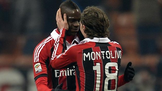 Mario Balotelli (L) is congratulated by team-mate Riccardo Montolivo (AFP)