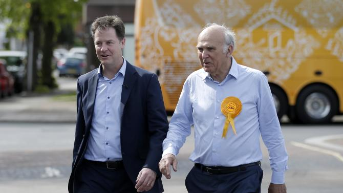 Britain's Liberal Democrat leader Nick Clegg campaigns with local candidate Vince Cable in Twickenham