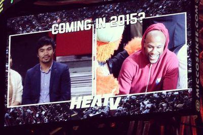 Floyd Mayweather and Manny Pacquiao met face-to-face at the Heat game