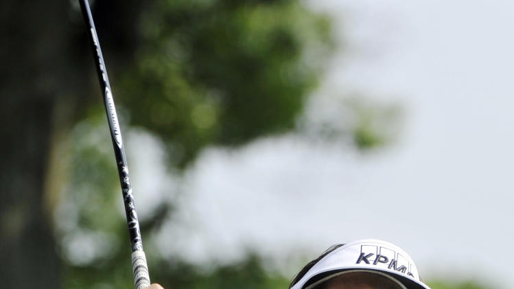 Phil Mickelson watches his tee shot on the 11th hole during the first round of the Bridgestone Invitational golf tournament at Firestone Country Club, Thursday, Aug. 2, 2012, in Akron, Ohio. (AP Photo/Phil Long)