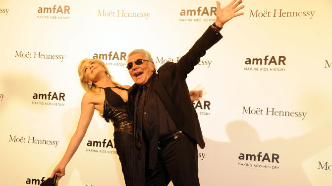 USA  Actress Sharon Stone, left, and Italian fashion designer Roberto Cavalli pose at the Amfar charity event, part of the Fashion Week in Milan, Italy, Saturday, Sept.22, 2012. (AP Photo/Giuseppe Aresu)
