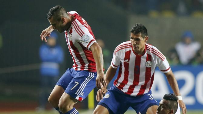 Paraguay's Bobadilla and Caceres challenges Peru's Cueva during their Copa America 2015 third-place soccer match at Estadio Municipal Alcaldesa Ester Roa Rebolledo in Concepcion