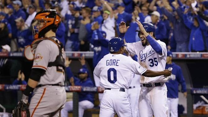 Kansas City Royals Terrance Gore (0) celebrates with his teammate Eric Hosmer, right, after scoring on an RBI doubly by Salvador Perez during the sixth inning of Game 2 of baseball's World Series against the San Francisco Giants Wednesday, Oct. 22, 2014, in Kansas City, Mo. (AP Photo/Matt Slocum)