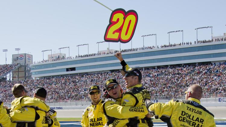 Pit crew members for Matt Kenseth celebrate after he won the NASCAR Sprint Cup Series auto race, Sunday, March 10, 2013 in Las Vegas. (AP Photo/Julie Jacobson)