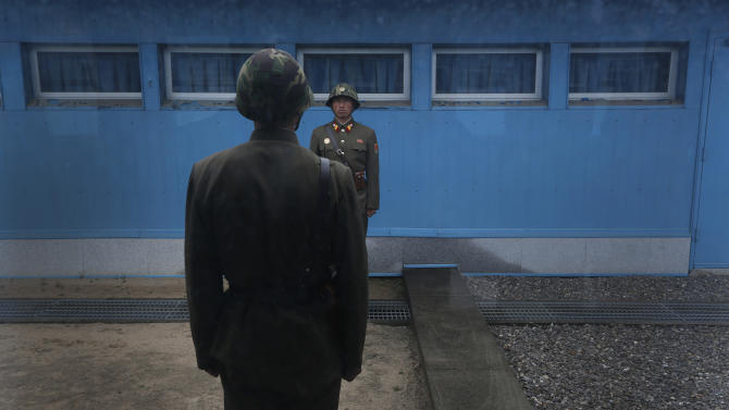"North Korean soldiers stand guard on the demarcation line of the Demilitarized Zone that separates the two halves of the Korean peninsula at Panmunjom, North Korea Monday, April 23, 2012. North Korea promised Monday to reduce South Korea's conservative government ""to ashes"" in less than four minutes, in an unusually specific escalation of recent threats aimed at its southern rival.   The statement by North Korea's military, carried by state media, comes amid rising tensions on the Korean peninsula. Both Koreas recently unveiled new missiles, and the North unsuccessfully launched a long-range rocket earlier this month. (AP Photo/Vincent Yu)"