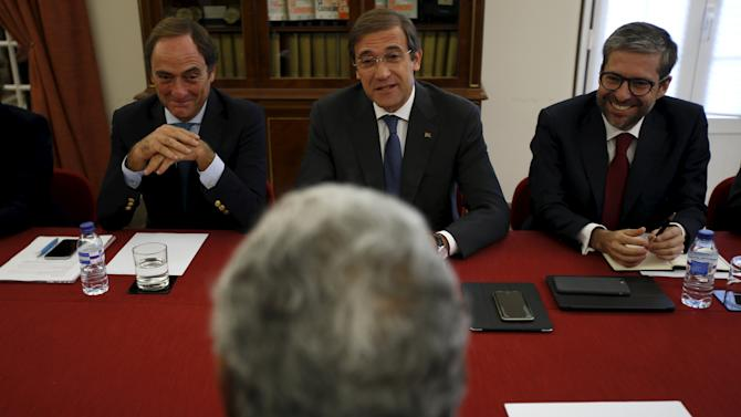 PM Passos Coelho speaks to Antonio Costa, leader of the opposition Socialist party (PS), during a meeting in Lisbon