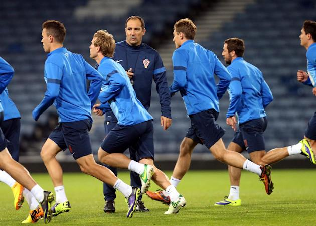 Croatia's manager Igor Stimac, centre left, watches his squad during a team training session at Hampden Park, Glasgow, Scotland, Monday Oct. 14, 2013. Croatia face Scotland in a World Cup qualifying G