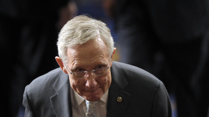 Senate Majority Leader Harry Reid of Nev. walks out of the House Chamber on Capitol Hill in Washington, Friday, Jan. 4, 2013, following the counting of Electoral College votes. Vice President Joe Biden presided over a Joint Session of Congress Friday as four members of the House and Senate took turns announcing the votes that had been tallied in state capitals last month affirming the re-election of Barack Obama as President of the United States. (AP Photo/Susan Walsh)