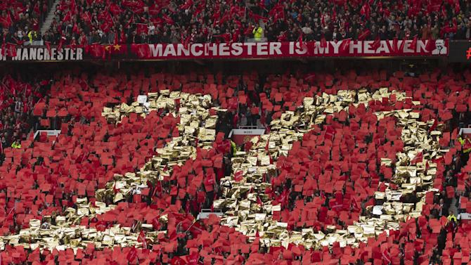 Supporter wave red flags before Manchester United manager Sir Alex Ferguson's last home game in charge of the club, their English Premier League soccer match against Swansea, at Old Trafford Stadium, Manchester, England, Sunday May 12, 2013. (AP Photo/Jon Super)