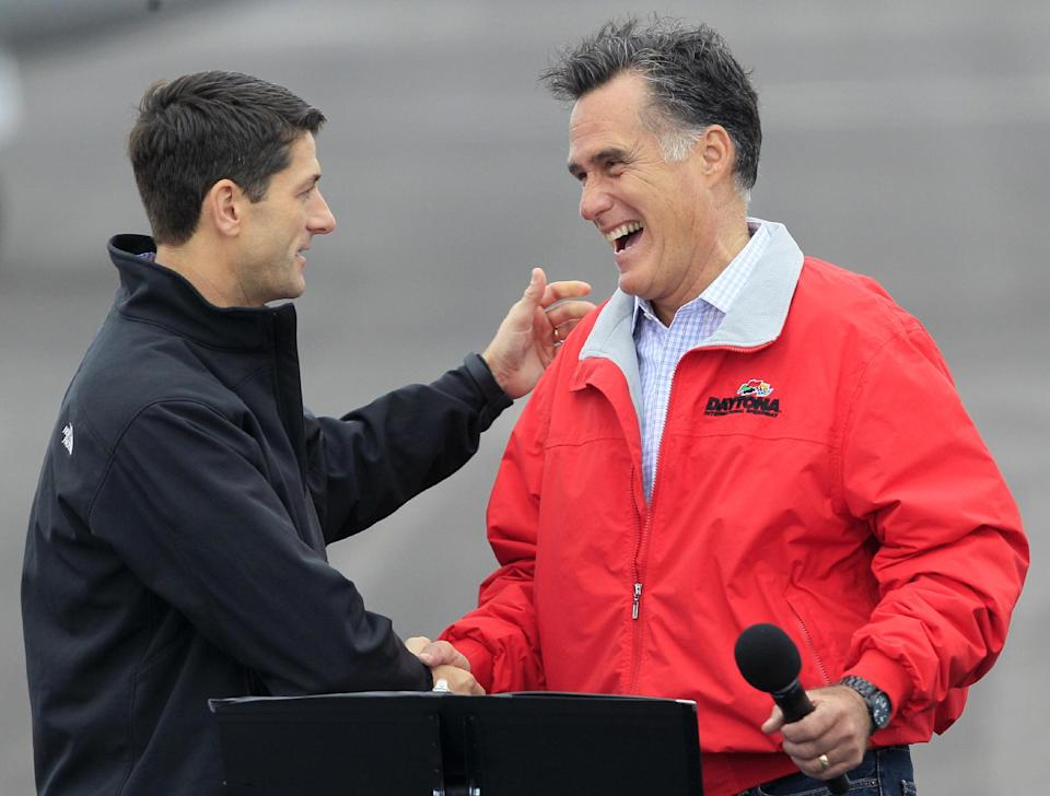 Republican presidential candidate former Massachusetts Gov, Mitt Romney is introduced by his running mate Rep. Paul Ryan, R-Wis., left, Tuesday, Sept. 25, 2012, at Wright Brothers Aviation in Vandalia, Ohio. (AP Photo/Al Behrman)