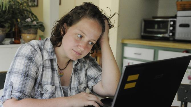 Catherine Devine, 22, reads instant messages on her laptop screen at her home in Kings Park, N.Y., Monday, Sept. 26, 2011. Devine had her first brush with an online bully in seventh grade, before she'd even ventured onto the Internet. A new Associated Press-MTV poll of youth in their teens and early 20s finds that most of them _ 56 percent _ have been the target of some type of online taunting, harassment or bullying, a significant increase over just two years ago. (AP Photo/Kathleen Malone-Van Dyke)
