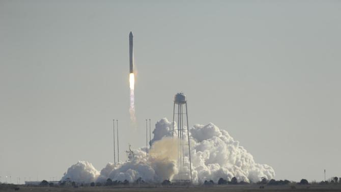 Orbital Science Corps.' Antares rocket lifts off from Wallops Island, Va. on Thursday, Jan. 9, 2014. The rocket is carrying the company's first official re-supply mission to the International Space Station. (AP Photo/Eastern Shore News, Jay Diem)
