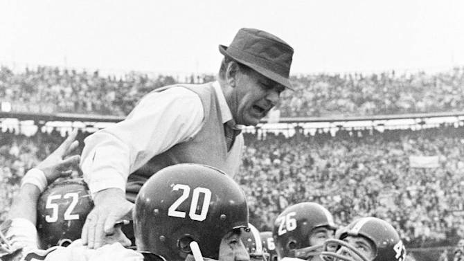 """FILE- In tis Jan. 2, 1967 file photo, Alabama coach Paul """"Bear"""" Bryant gets a ride on the shoulders of his team after Alabama beat Nebraska 34-7 in the Sugar Bowl NCAA college football game in New Orleans. At a time when college football was generally considered the domain of eastern blue bloods, Notre Dame and Alabama were upstart teams that gave blue collar fans a chance to tweak the elite. About 90 years later, the Fighting Irish and Crimson Tide are the elite - two of college football's signature programs, set to play a national championship next Monday in Miami that could break records for television viewership. (AP Photo/File)"""